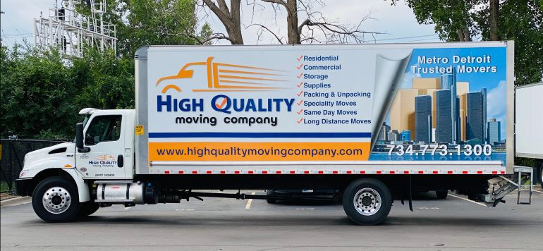 High Quality Moving Company truck, with list of services on it.