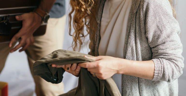 Woman packing wardrobe