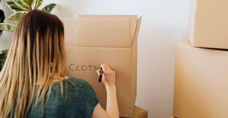 Woman labeling a moving box
