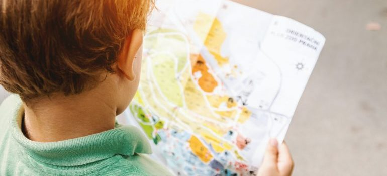 A child looking at a map.