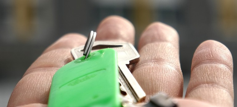 a person holding keys