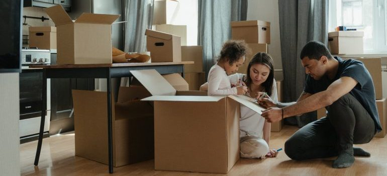 Family in the middle of a move, with the help of our movers Livonia MI