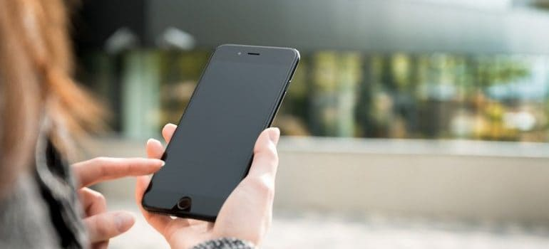 A girl holding a phone.