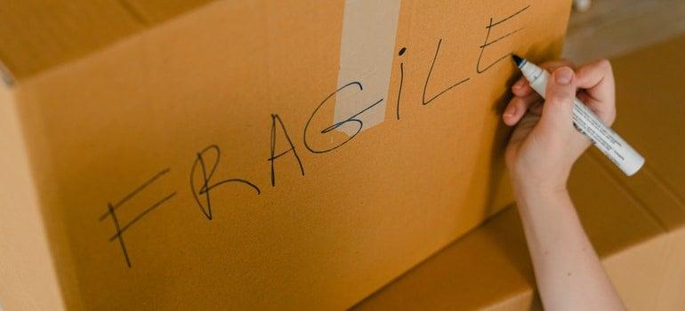 Person labeling a box