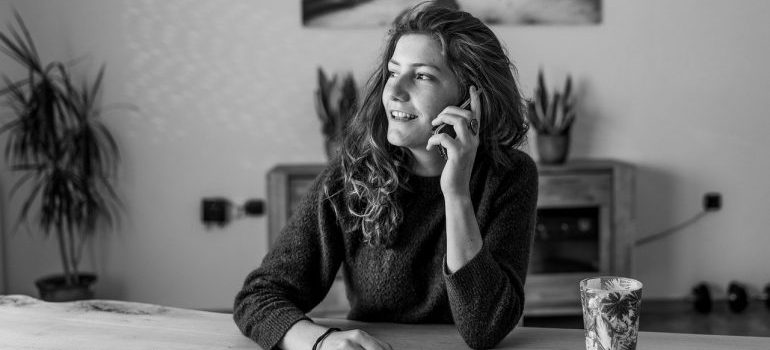 A black and white photo of a woman on the phone.