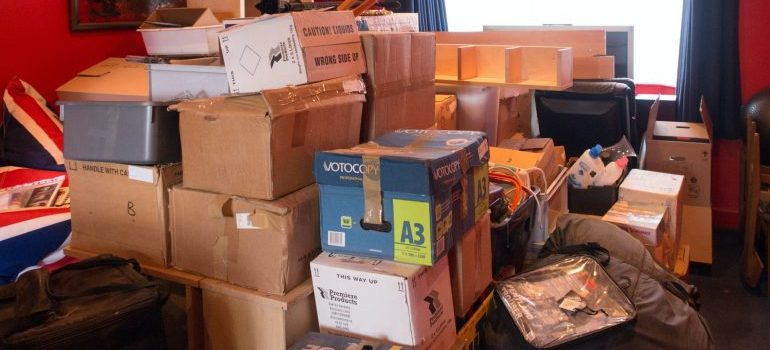 A pile of moving boxes on the floor