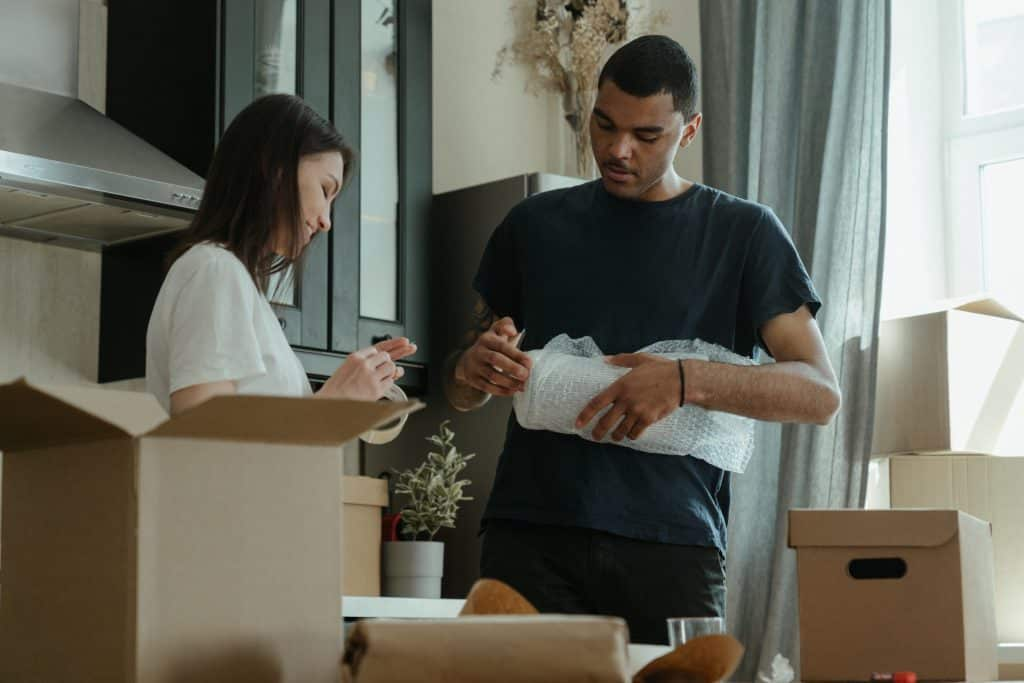 Young couple packing for relocation