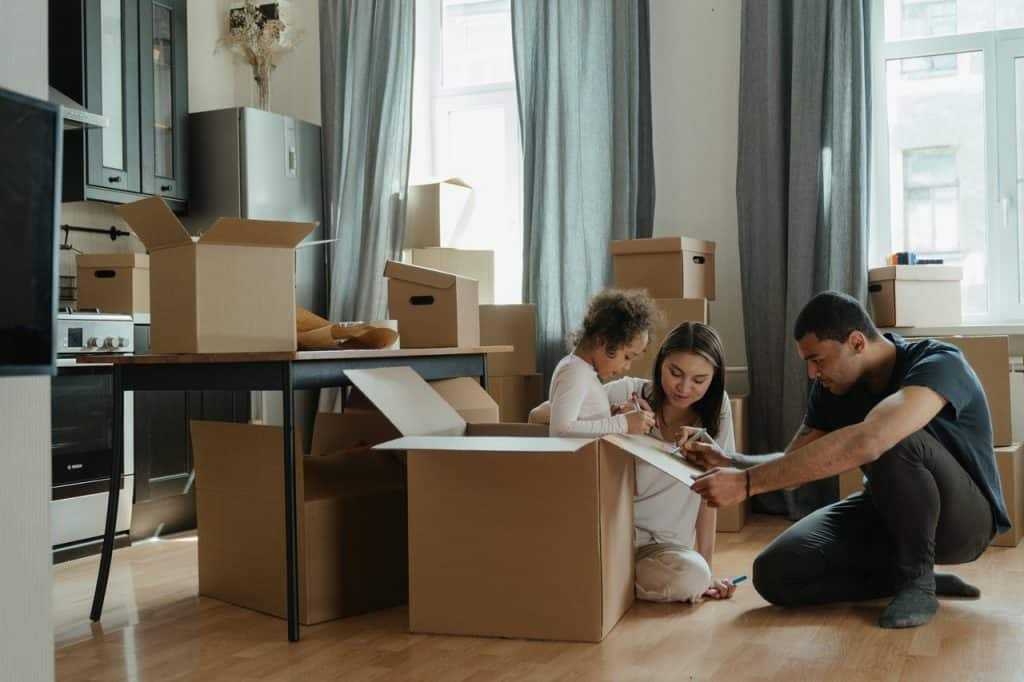 Picture of a family packing for the move