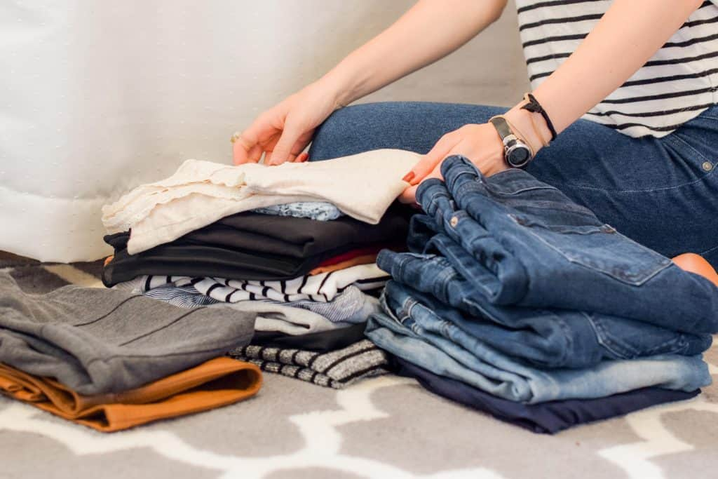female folding clothes