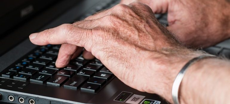 Senior typing on a computer