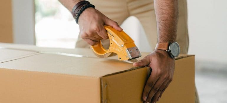 Create an inventory list for moving and close all boxes with packing tape.