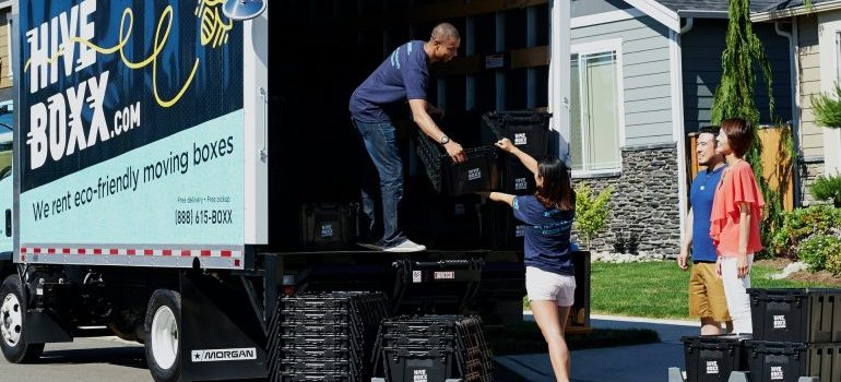 People loading truck for moving to White Lake, MI