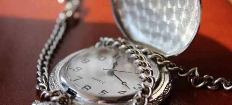 An antique watch as one of the items you should personally transport.