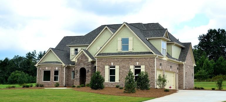 A large suburban home with a brick facade.