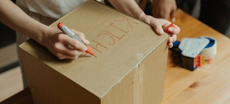 Labeling a moving box.