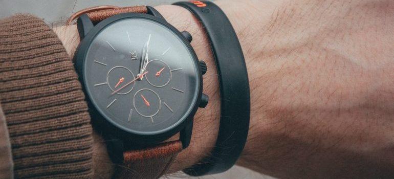 A wristwatch on a man