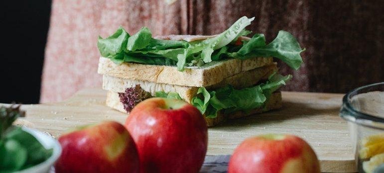 A person making a sandwich