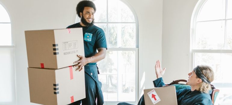 Two guys moving boxes