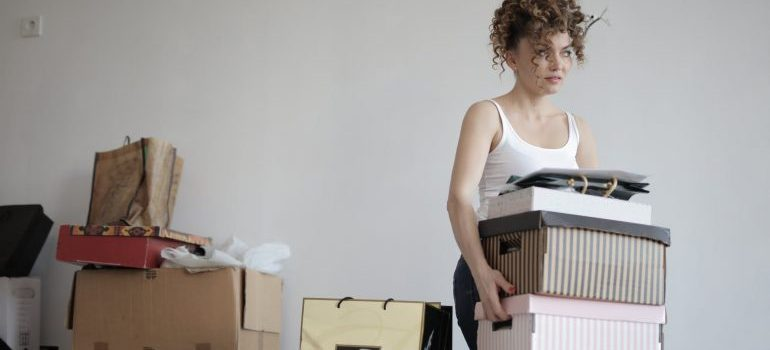woman carrying the boxes